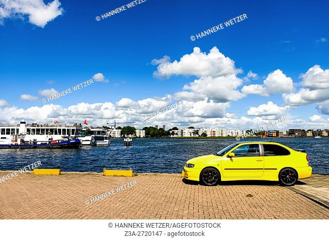 Yellow car at the Ij in Amsterdam, Holland, Europe