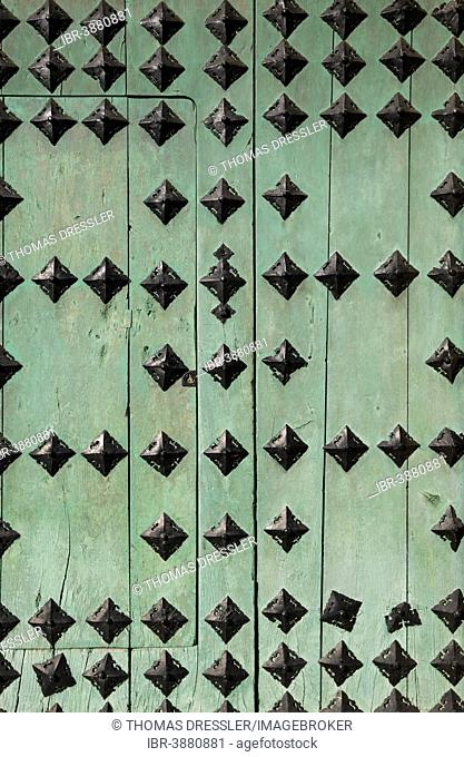 Door with decorative iron spikes, historic district of Córdoba, Córdoba province, Andalusia, Spain