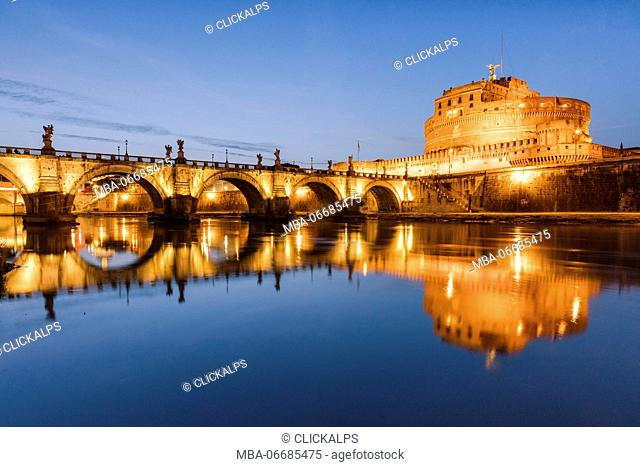 Dusk on the ancient palace of Castel Sant'Angelo with statues of angels on the bridge on Tiber RIver Rome Lazio Italy Europe