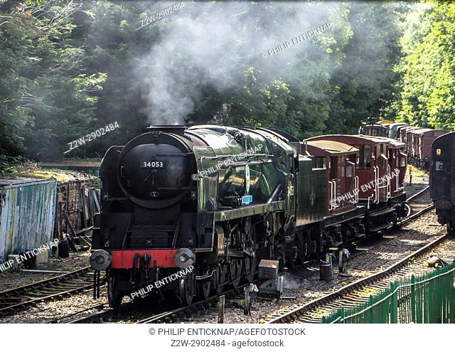 "Rebuilt Battle of Britain Class No 34053 """" Sir Keith Park """" with a train of breakvans at Alresford on the Mid Hants Railway during the railway's End of..."