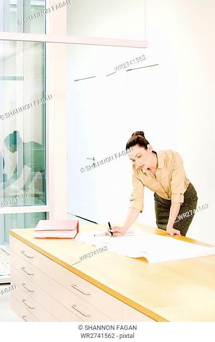 Female architect drawing