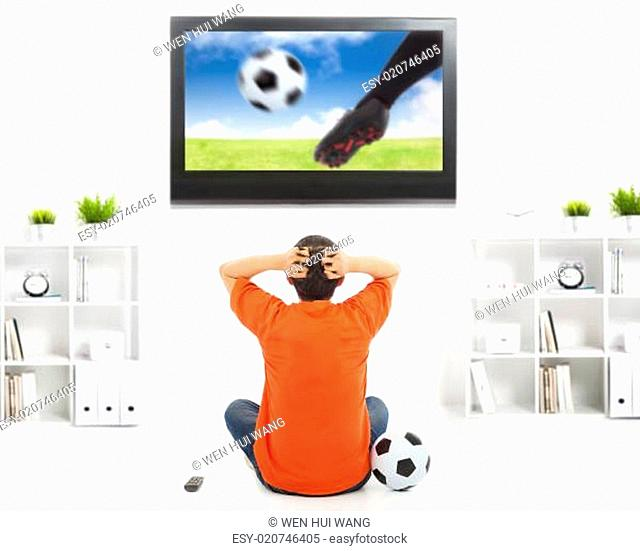 fan watching soccer game and feeling nervous