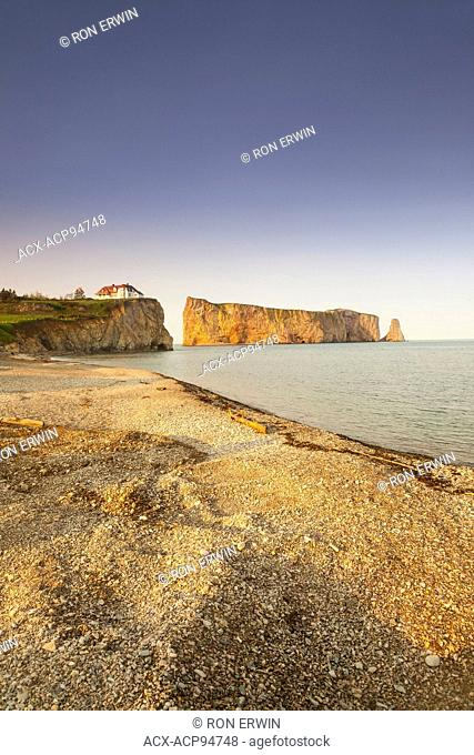 Historic buildings and the giant pierced rock at Perce, Quebec, Canada