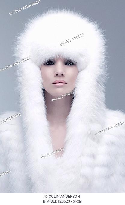 Pacific Islander woman wearing fur hood