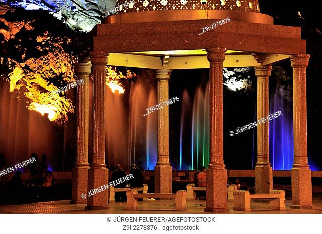 Omani enjoy at night the light show and the fountains in the park of Mutrah, Sultanate of Oman