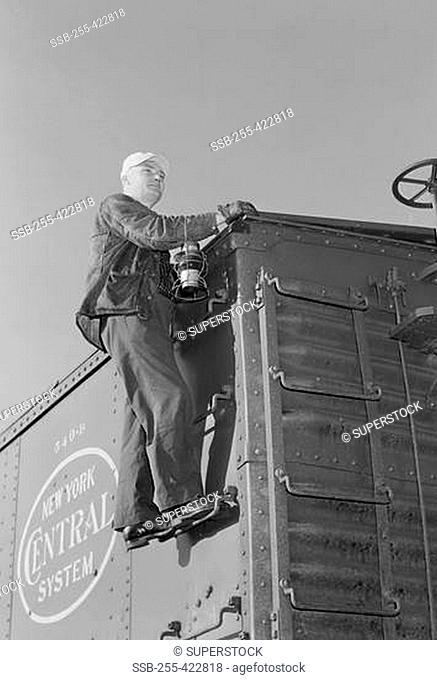 Man inspecting train
