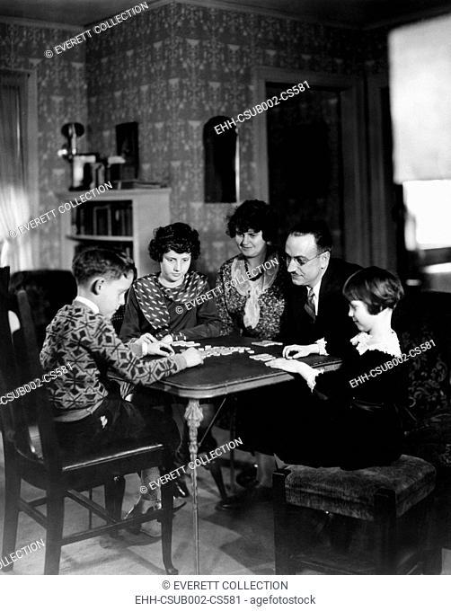 Dr. Karl A. Menninger, psychiatrist, playing a game with his family. Ca. 1930. L-R: Robert Gaines, Julia, Mrs. Menninger, Dr. Menninger, and Martha