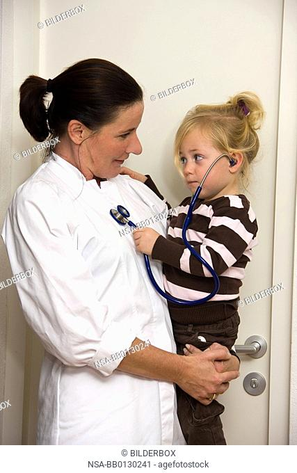 Children's doctor examines a child in surgery