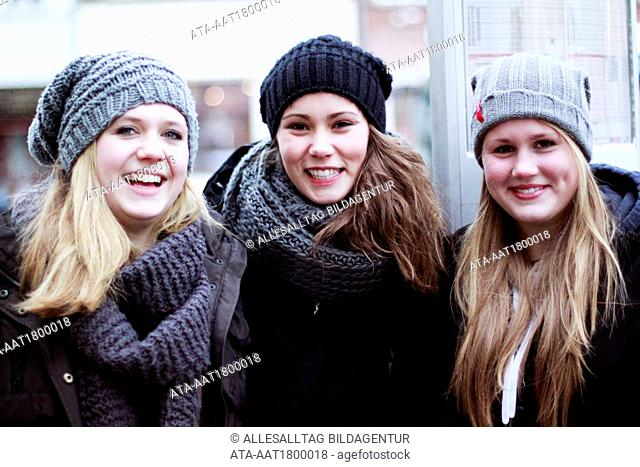 Three young girls in the winter