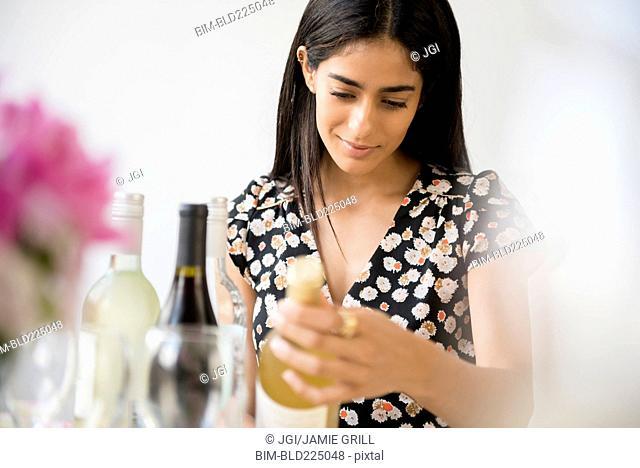 Indian woman choosing bottle of wine