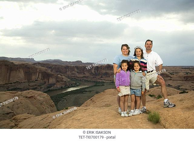 Portrait of family in front of canyon