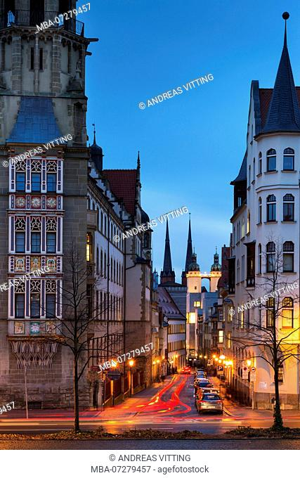 Germany, Saxony-Anhalt, Halle (Saale), view to the market square and the towers of the Marktkirche, left the bay window of the district court, dusk