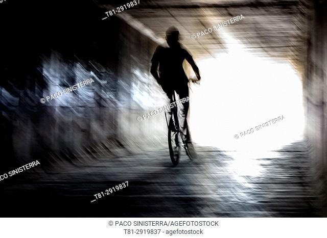 Boy on a bike crossing a tunnel, Alboraya, Spain