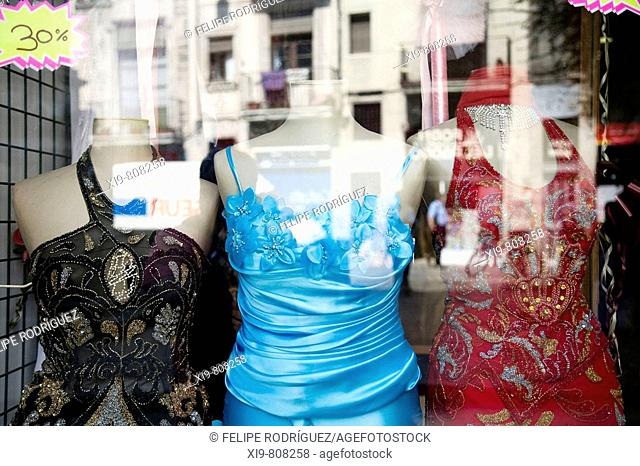Evening gowns in a Maghribian shop window, Carrer Hospital in El Raval neighborhood, Barcelona. Catalonia, Spain
