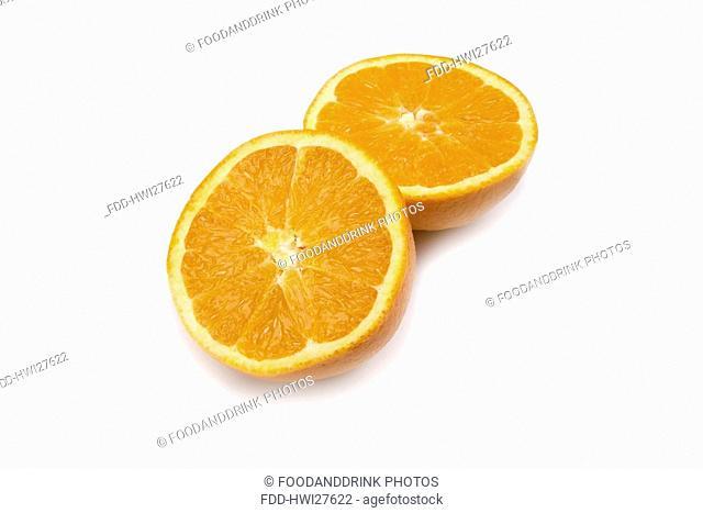 Orange halves on white background