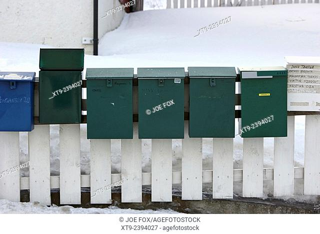 private mail boxes on the fence outside an apartment block kirkenes finnmark norway europe