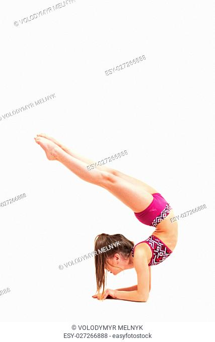 The teenager girl doing gymnastics exercises isolated on a white background