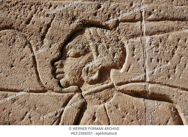Detail of a relief of captured Nubian prisoners of war, Temple of Rameses II, Abu Simbel, Egypt. The great rock-cut Temple of Abu Simbel was built during the...