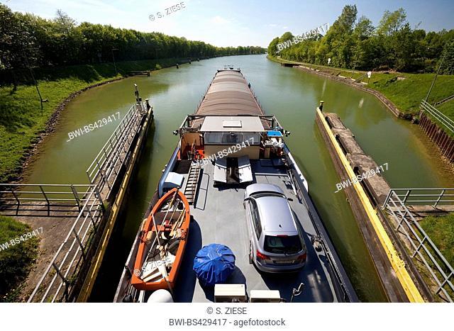 barge leaving the lock Bevergern, Dortmund Ems Canal, Germany, North Rhine-Westphalia, Muensterland, Hoerstel