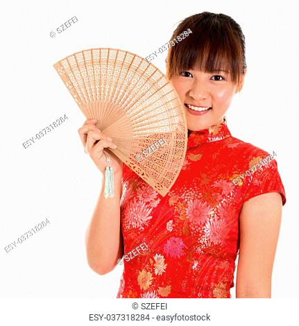 10b26b346 Beautiful Asian girl with Chinese traditional dress Cheongsam holding a Chinese  Fan isolated on white background