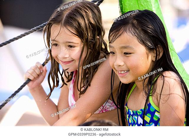 Two smiling young girls at water park