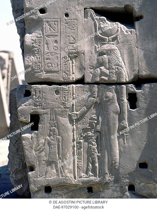 The Goddess Hathor protecting the king, relief, east exterior wall of the Great Hypostyle Hall, Karnak temple complex (Unesco World Heritage List, 1979)