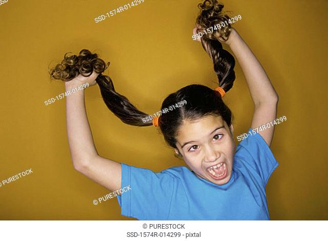 Close-up of a girl pulling her hair