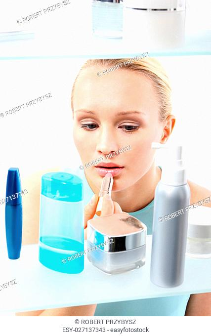 shopping spree - woman in cosmetic shop. female,client standing at the shelf and selects cosmetics