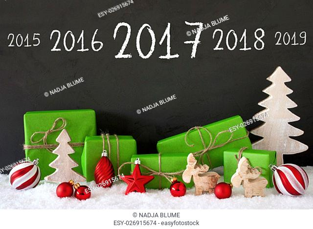 Timeline 2017 For Happy New Year. Green Gifts Or Presents With Christmas Decoration Like Tree, Moose Or Red Christmas Tree Ball