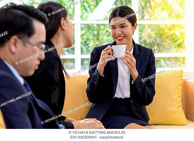 Business people having a conversation in the cafe on coffee time