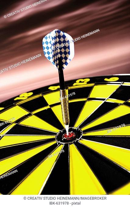 Dart arrow hitting bullseye