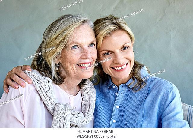 Portrait of mother and adult daughter head to head