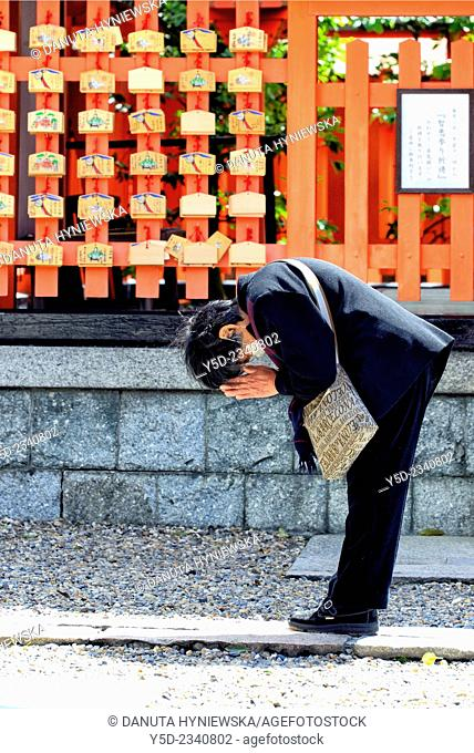 single person pryaing at Fushimi Inari-taisha Shrine, head shrine of Inari located in Fushimi-ku, Kyoto, Kansai Region, Japan
