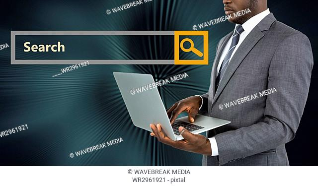 Businessman using laptop by search bar
