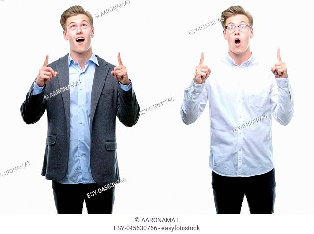 Young handsome blond business man wearing different outfits amazed and surprised looking up and pointing with fingers and raised arms