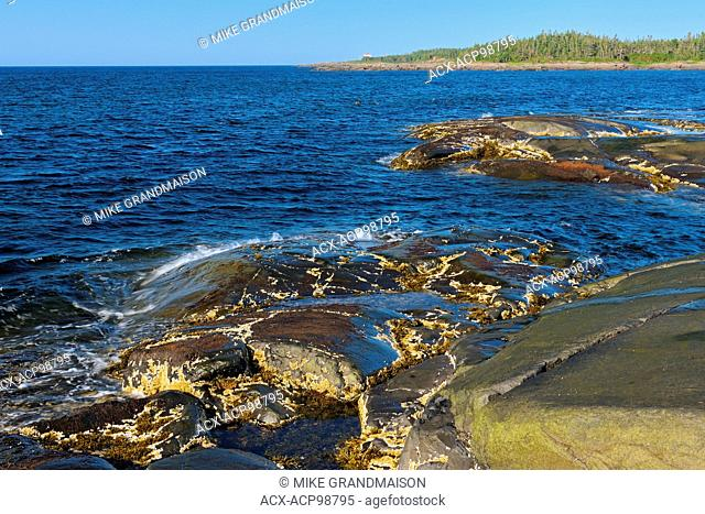Rocky shoreline of the Gulf of St. Lawrence Pointe des Monts Quebec Canada