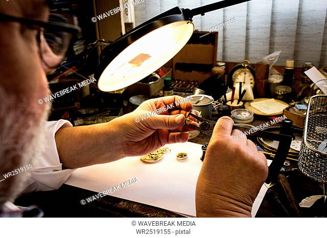 Close-up of horologist repairing a watch