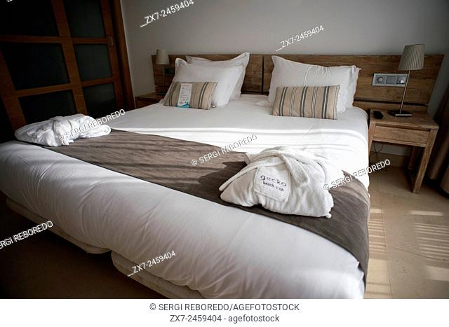 Gecko luxury boutique Hotel, Migjorn beach, Formentera Island, Balearic Islands, Spain, Europe. Bed inside a luxury room
