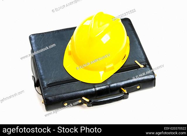 Construction concept - case and hard hat isolated on white