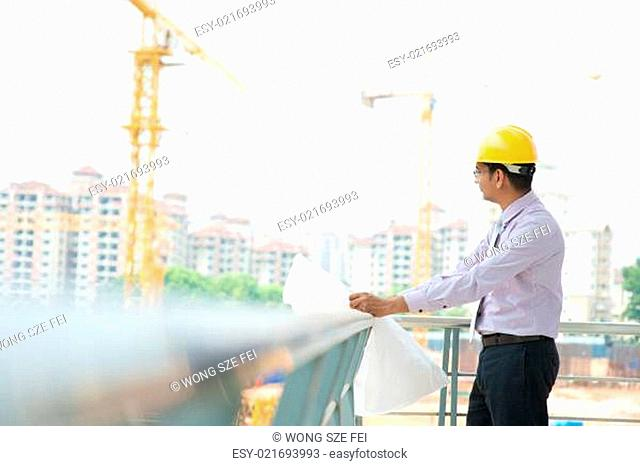 Asian Indian architect at construction site