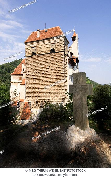 Stone Cross in front of the Bran castle, according to the legend known as Dracula's castle, Wallacia, Carpathian Mountains, Romania