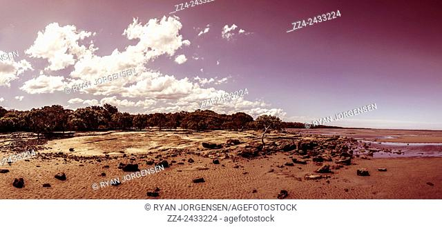 Six photo stitch wide angle of a selenium toned rocky beach landscape, taken Deception Bay, Queensland, Australia