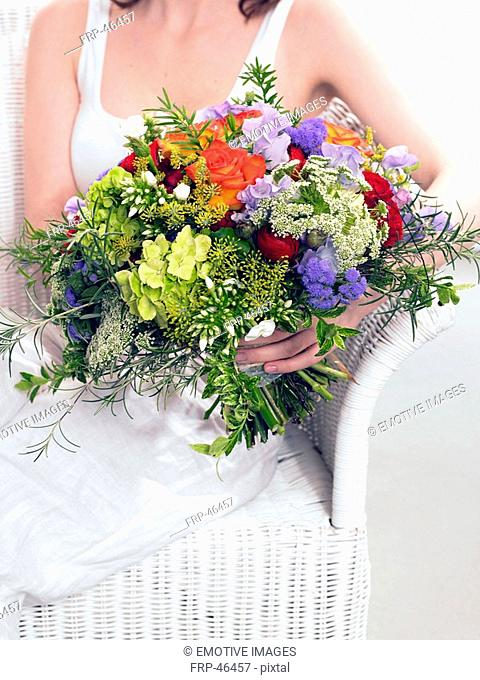 Summery bouquet of roses, phlox, dill and sweet pea