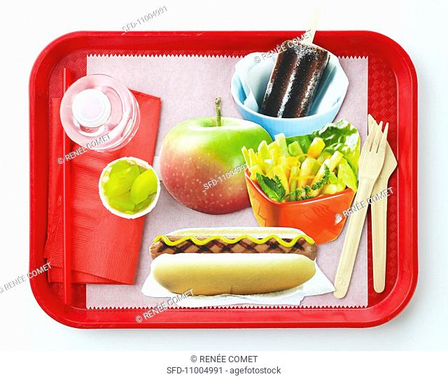School Lunch Tray with Hot Dog, Salad, Apple and Popsicle, White Background
