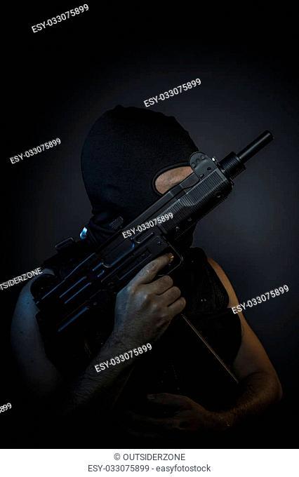 Criminal, Man wearing balaclavas and bulletproof vest with firearms