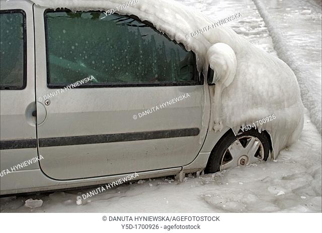 Severe winter, frozen car trapped in ice, Versoix, canton of Geneva, Lake Geneva region, Lake Geneva shore, Switzerland, water was blown out from the lake by...