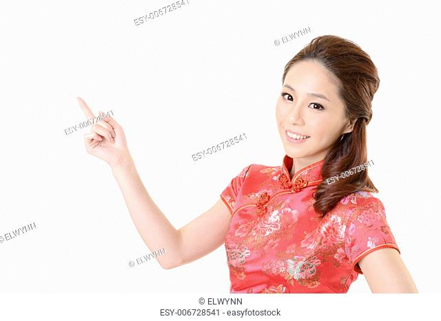 Smiling Chinese woman dress traditional cheongsam and introduce on white background