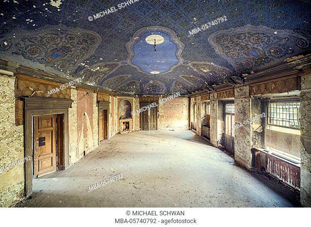 Ballroom with blue ceiling in a former castle somewhere in Europe