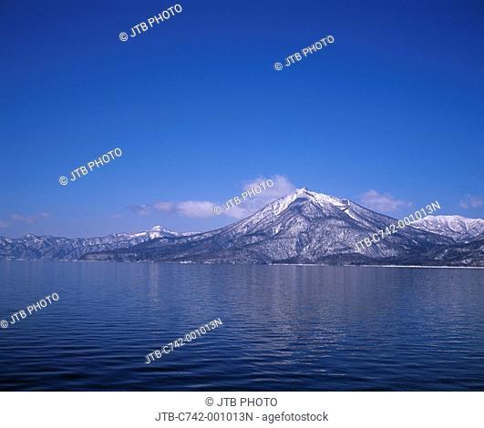 Blue sky Clouds Snow-covered mountain Sea Winter Lake Shikotsu Mt  Eniwa Chitose Hokkaido Japan