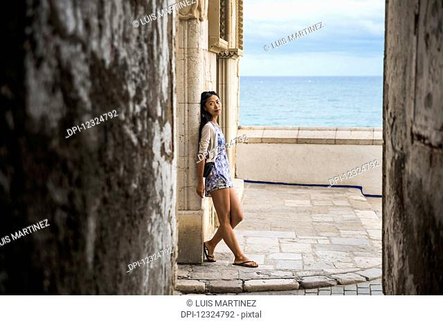 Portrait of a Chinese young woman in Maricel Palace; Sitges, Barcelona province, Spain